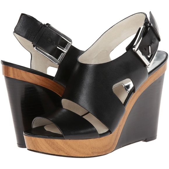 005671460e3 Michael Kors Carla Black Leather Wedge Sandals. M 5a83b26ccaab443032501286